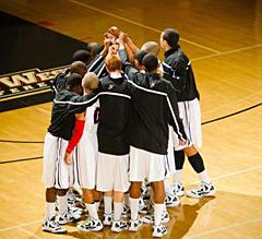 Basketball Team huddling.