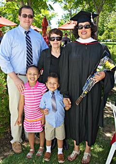 Christina Henry with family at graduation.