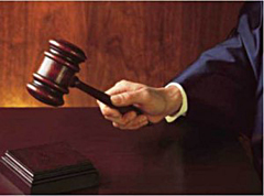 Gavel in judge's hand.