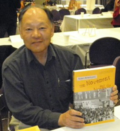 Glenn Omatsu with a book.
