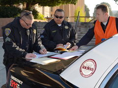 CSUN police offers reviewing plans during an Emergency Center Operations drill on the CSUN campus.