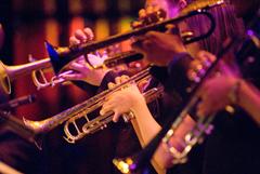 "Close up of CSUN Jazz ""A"" band musicians playing brass instruments."