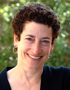 Naomi Oreskes standing in front of greenery