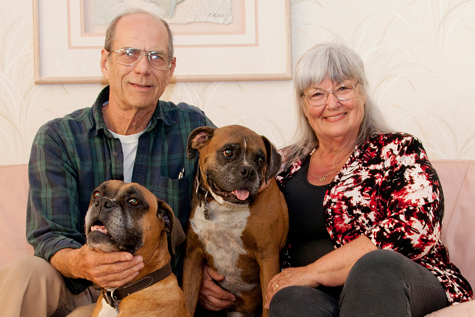 CSUN donors Dr. Richard and Ilona Buratti at home with their beloved boxers, Travis and Phoebe.