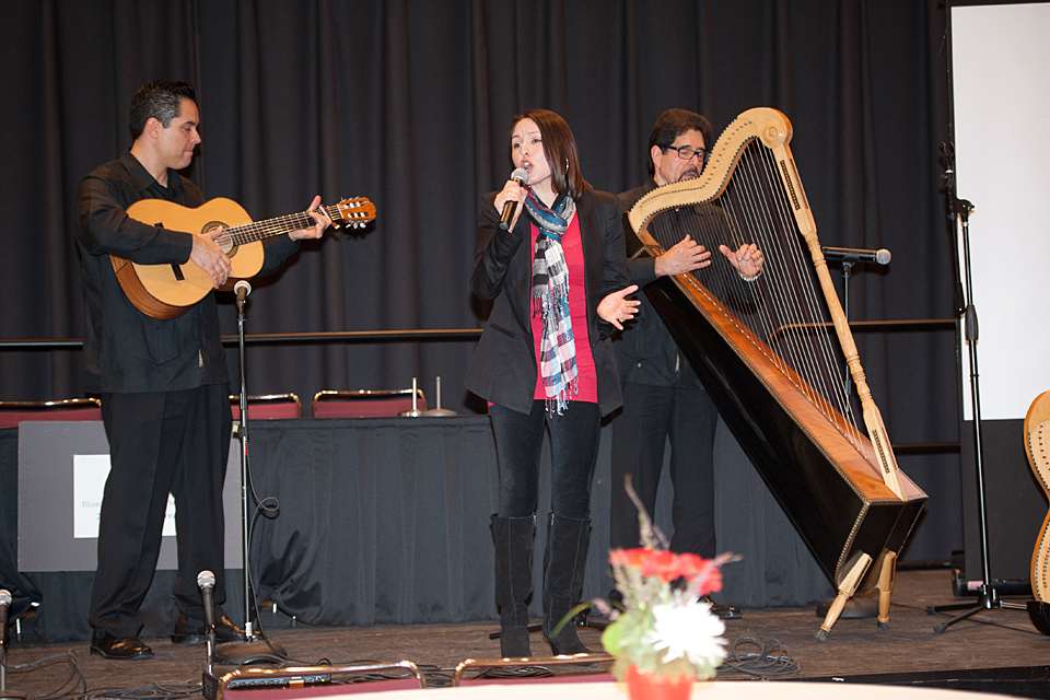 Chicano studies professor Fermin Herrera playing the Mexican harp with his daughter singing and son playing guitar. His presentation titled Reworking Mexicos Musical Heritage: A Chicanos Experience focused on the embrace of traditional Mexican music by Mexican American culture.