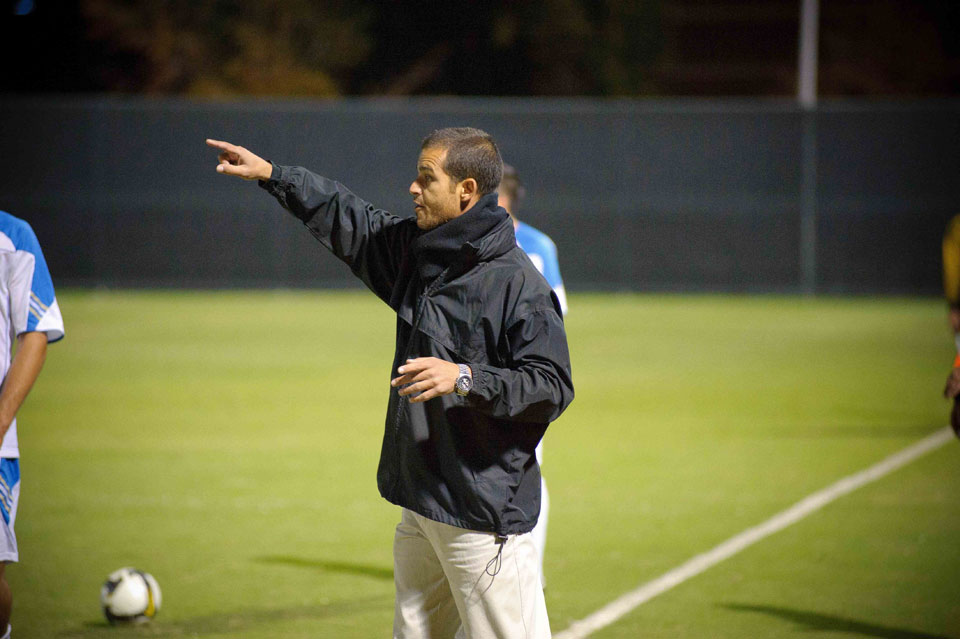CSUN's associate head soccer coach Yossi Raz looks on from the sidelines.