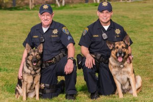 Members of CSUN's police services: Cpl. Tom Finnerty (with Mitch) and Ofcr. Felix Anthony Vargas (with Isy).