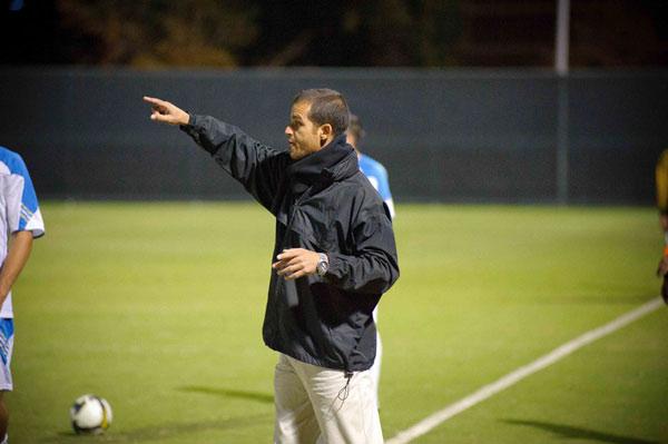 CSUN's associate head soccer coach Yossi Raz watches from the sidelines as the Matadors play UCLA. Raz was named the new head coach of the Cal Poly Pomona Broncos men's soccer team.