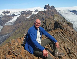 Darrick Danta sitting atop Kristinartindar Peak in Iceland in June 2012.