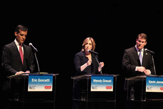 City Councilman Eric Garcetti, City Controller Wendy Greuel, attorney and radio talk show host Kevin James behind podiums on stage.