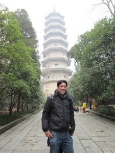 Dale Chang in front of a traditional Chinese tower.