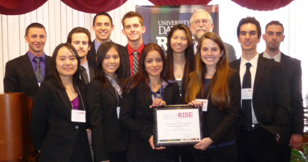 The CSUN team holding their award