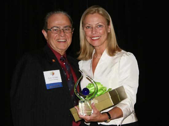 CSUN President Dianne F. Harrison accepts award.