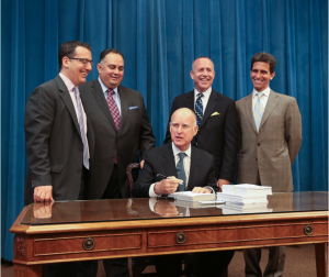California Gov. Edmund G. Brown Jr. signs the 2013-14 state budget. Photo courtesy of the Office of Governor Edmund G. Brown Jr.